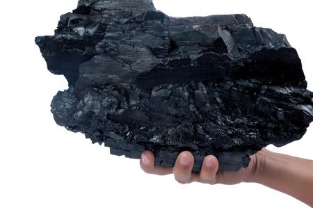 Männliche Hand, einen großen Klumpen von Kohle auf weißem Hintergrund Standard-Bild - 10111137