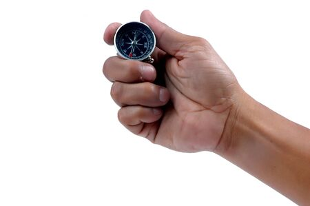 man's hand holding a compass isolated on white backgrund Stock Photo - 10111158