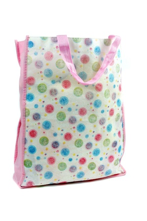a colorful cotton bag isolated on white background photo