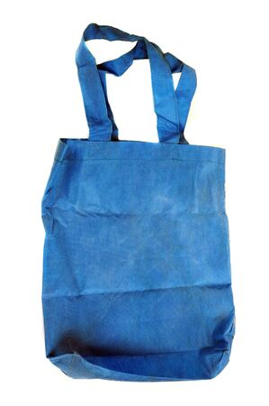 a blue cotton bag isolated on white background photo