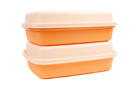 stack of orange storage plastic containers isolated on white background Imagens