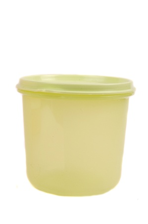 tupperware: green storage plastic containers isolated on white background Stock Photo