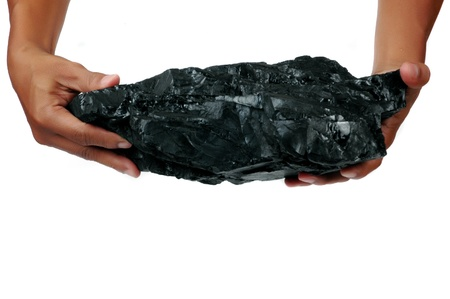 a big lump of coal is held with two hands isolated on white background photo