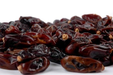 fresh dates fruit isolated on white background photo