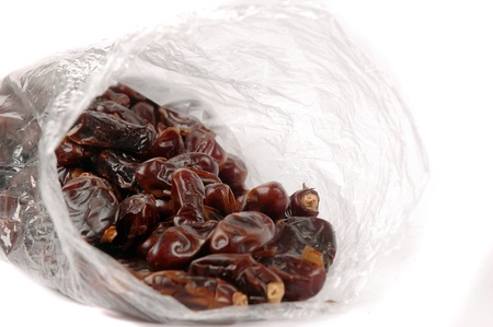 date palm fruit in a plastic bag packaging isolated on white background photo