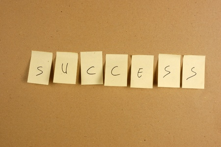 writing success is spelled in a sheet of paper affixed to the wall brown carton Stock Photo - 10518030