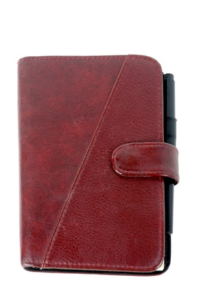 diary cover: a closed brown leather notebook isolated on white background Stock Photo