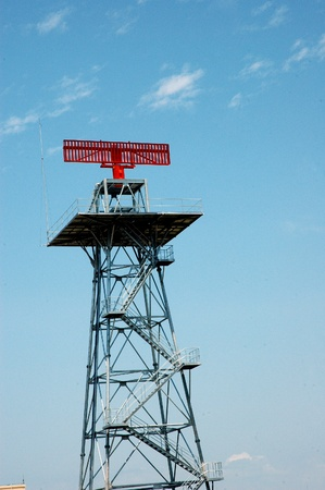 a tower with red radar photo