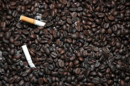 neutralize: coffee beans as the ashtray to neutralize cigarette smoke