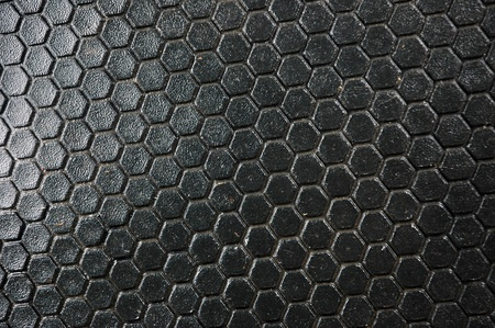 honeycomb pattern on the black rubber mats photo
