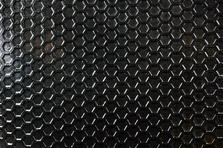 honeycomb pattern on the black rubber mats