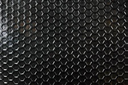 Wabenmuster auf dem schwarzen Gummimatten Standard-Bild - 11888110