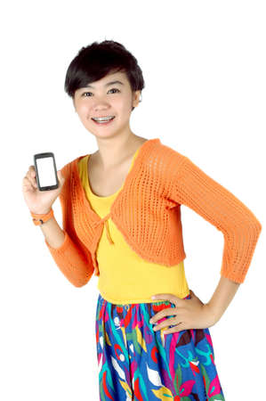 a beautiful woman shows a touch screen mobile phone in his hand isolated on white background Stock Photo - 11888090