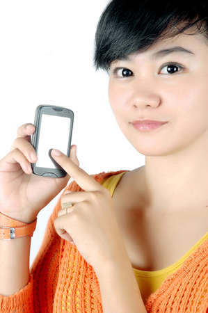 a beautiful woman shows a touch screen mobile phone in his hand isolated on white background photo