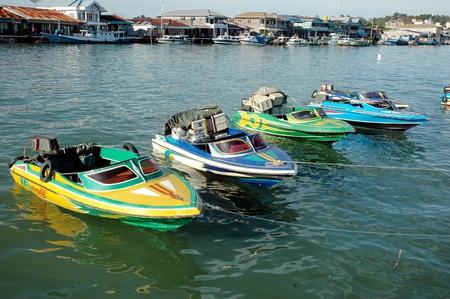 speedboats: TARAKAN,INDONESIA-DECEMBER 2011 : four speedboats are anchored at the port of SDF Tarakan, Indonesia Editorial