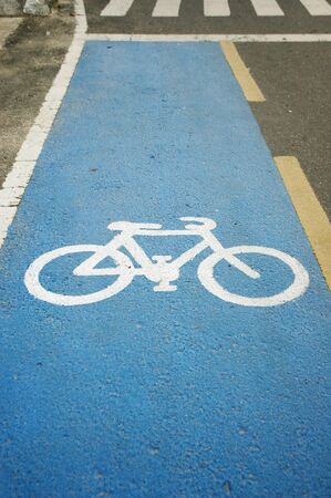 bicycle lane symbol on a paved highway photo