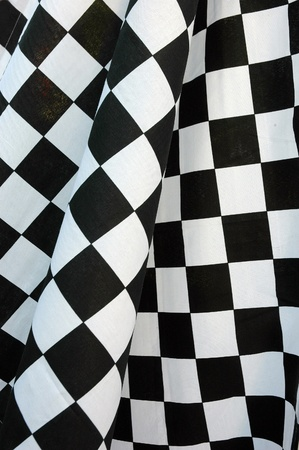 detailed pattern of black and white checkered flag at the start photo