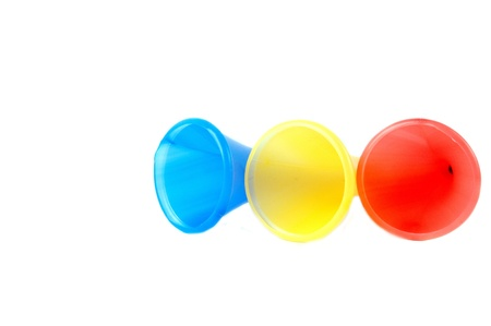 three colorful plastic terumpet isolated on white background photo