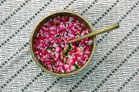 flower petals in water with golden scoop in used in Javanese Indonesia  traditional wedding ceremony