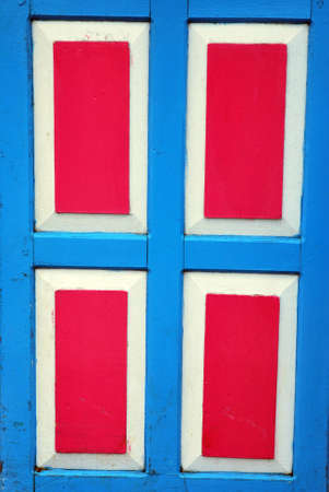 red and blue wooden door photo