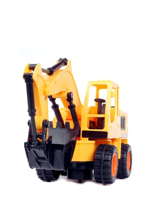 plastic toy excavator isolated on white background photo