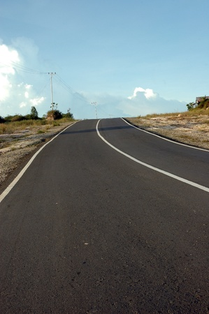 uphill road leading to the blue cloud photo