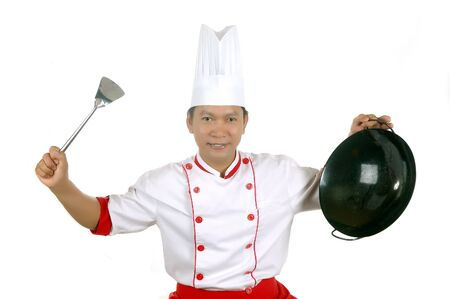 culinary skills: chef holding cooking utensils isolated on white background