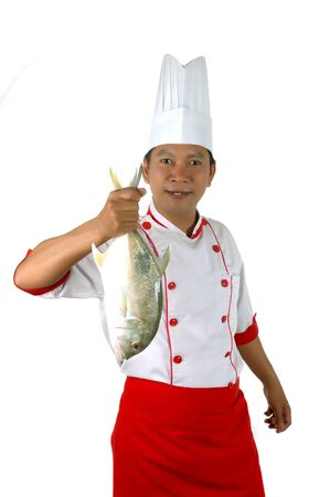 chef holding a big raw fish isolated on white background Stock Photo - 13228175