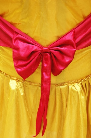 golden yellow cover seat with red ribbon photo