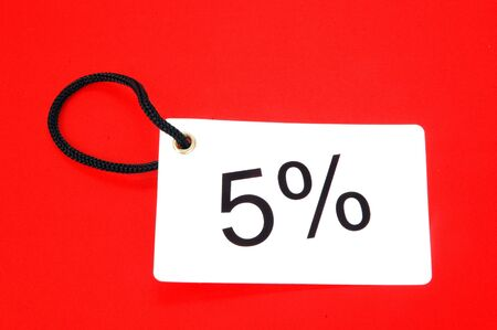 five percent red paper tag isolated on white background photo