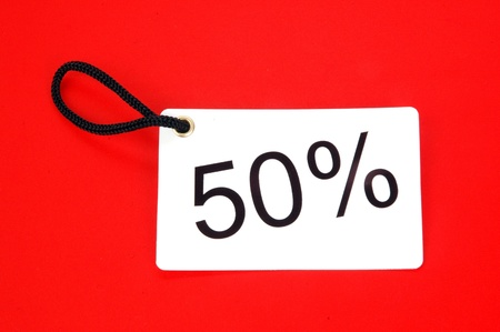 fifty percent paper tag isolated on white background photo
