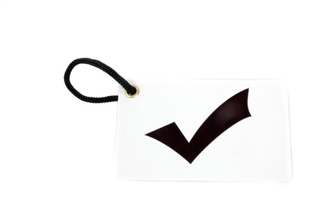 tally: white paper tag labeled with checkmark symbol isolated on white background Stock Photo