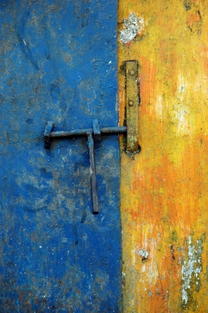 latch the door on the faded blue and yellow wall photo
