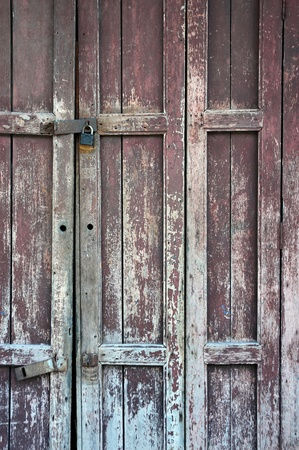 wooden door with a faded paint photo
