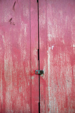 wooden door with red faded paint photo