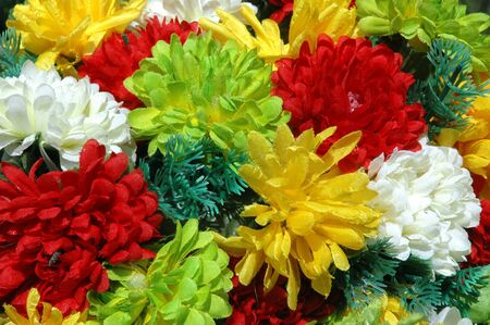 composition of colorful  the artificial flower decorations for background photo