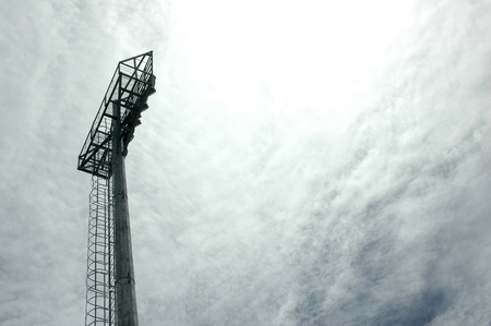 stadium light poles with white clouds backgrounds photo