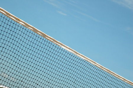 beach volleyball net with blue sky background photo