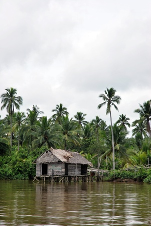 an old house on the banks of the river in rural areas photo