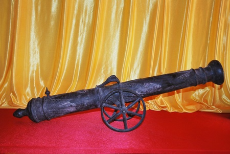 ancient objects made of iron in the form of little canon in a museum of history photo