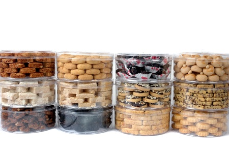 stack of various kinds of pastries in a transparent jar packaging