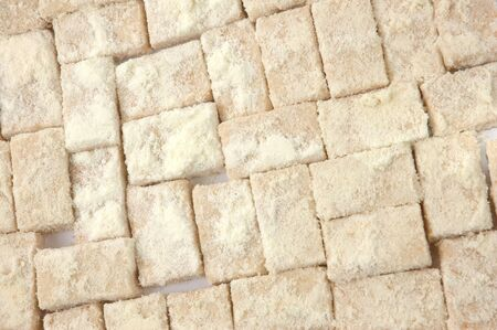 pattern of sweet pastries sprinkled with powdered milk photo