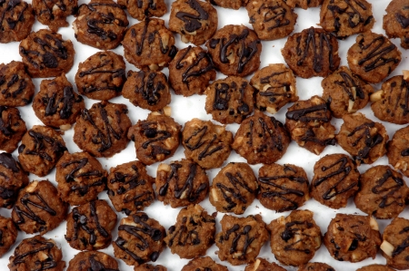 pattern of cookies with additional chocolate dilute and peanut photo