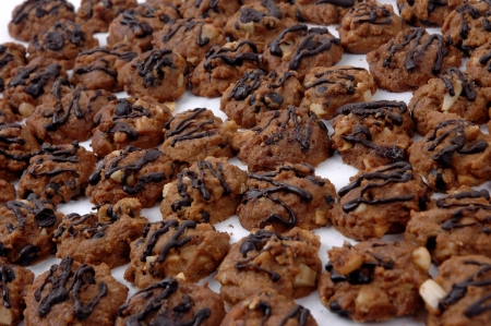 dilute: pattern of cookies with additional chocolate dilute and peanut Stock Photo