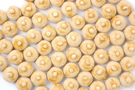 pattern of pastries with a wash of egg yolks and nuts Stock Photo - 14722276