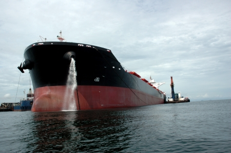 the bow of a big tanker ship, which was anchored in the middle of the ocean