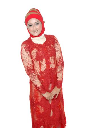 portrait of an asian young girl dressed in kebaya traditional isolated on white background photo