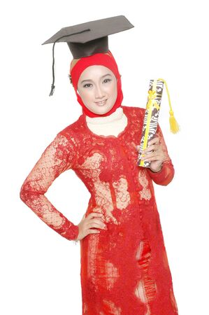 portrait of an asian young girl  holds a diploma of graduation isolated on white background photo