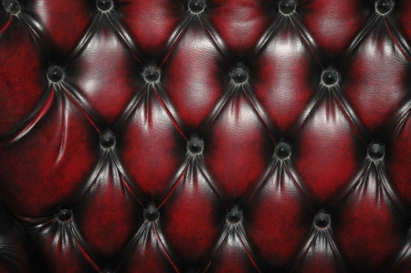 texture and pattern of red dark leather seat upholstery photo
