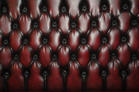texture and pattern of red dark leather seat upholstery